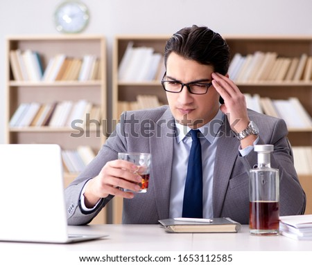 Young businessman drinking from stress #1653112585