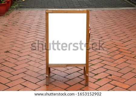 White Blank Advertisement wooden Billboard Banner Sign On the brick ground. Mock Up Isolated Template Clipping Path. Captured in Taipei, Taiwan.