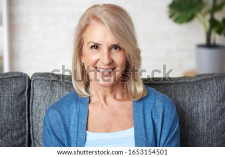 Senior blonde lady. Beautiful old woman is smiling toothy #1653154501