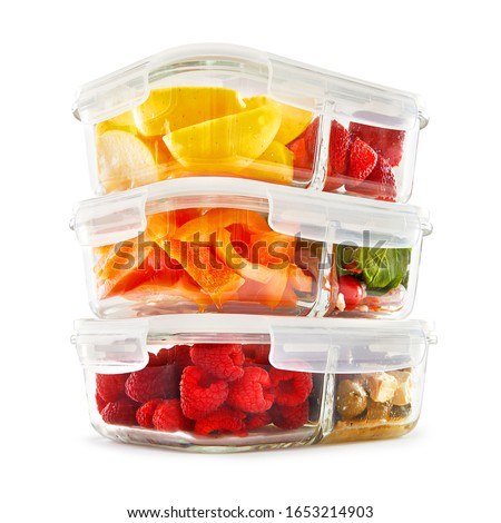 Glass Meal Prep Containers Isolated on White Background. Set of 3.3 Oz Food Storage Containers with 2 Compartment and Vented Lids Filled with Fruits and Vegetables Front Side View #1653214903