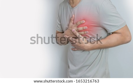 Hands holding chest with symptom heart attack disease Royalty-Free Stock Photo #1653216763
