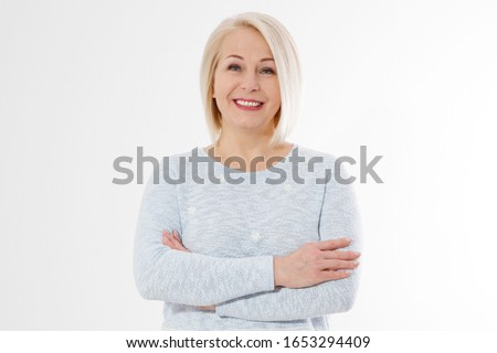 Happy beautiful close up portrait middle age blonde woman. Mid aged healthy female isolated on white background with copy space. Menopause and healthcare. Mature lady wrinkled face. Folded hands #1653294409