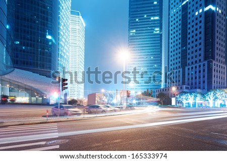 the light trails on the modern building background in shanghai china.  #165333974
