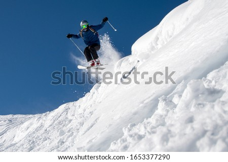 Young man skiing jumping in the air #1653377290