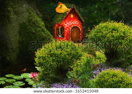 Fruit fairy house in a fantastic forest at the foot of a tree with a garden and flower beds for fairy characters.Children's fairy magic landscape