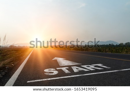 Concept of start straight and beginning for cooperation.Start text on the highway road concept for planning and challenge or career path,business strategy,opportunity and change in sunset background. #1653419095