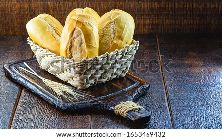 "traditional Brazilian bakery bread, known in Brazil as ""french bread"" or bread, thick dough, bagel, bald bread, filo, jacó or carioquinha. #1653469432"