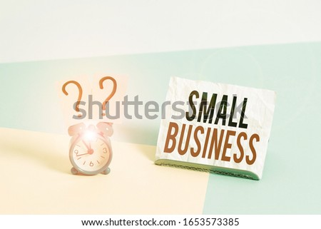 Writing note showing Small Business. Business photo showcasing privately owned corporations that has less employees Alarm clock beside a Paper sheet placed on pastel backdrop. #1653573385