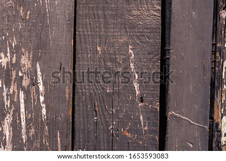 Old wooden plank with weathered paint #1653593083