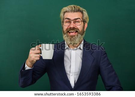All I need is caffeine. Happy teacher hold coffee cup green chalkboard. Enjoying hot caffeine drink. Coffee break. Using caffeine stimulant. Caffeine addiction. #1653593386