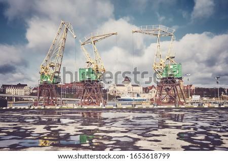Port cranes on Szczecin Lasztownia island, color toning applied, Poland. Royalty-Free Stock Photo #1653618799