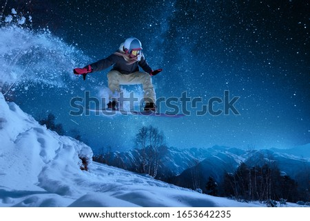 night skating girl is jumping with snowboard from the hill under the starry sky and moonlight #1653642235