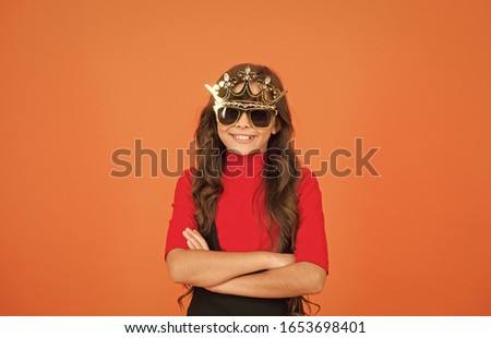 Confident big boss. Small girl keep arms crossed with confidence. Little child with confident look. Confident kid wear prop crown and glasses. School prom. Beauty queen. Confident and proud. #1653698401
