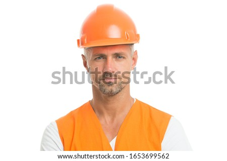 man in helmet. wear construction helmet on building site. Builders dressed in protective vest and helmet. Construction worker isolated on white. skilled technician in safety helmet. social work. #1653699562