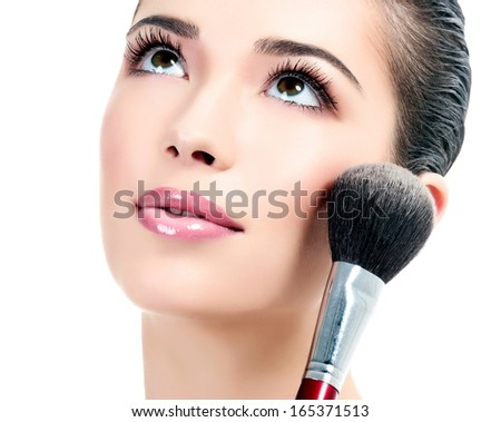 Pretty woman with a cosmetic brush, white background  #165371513