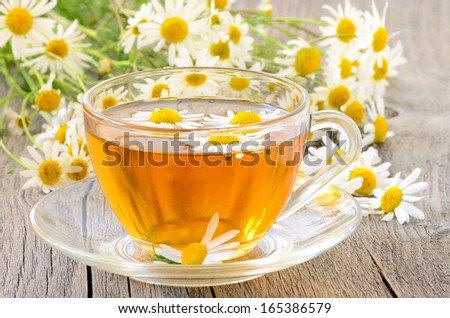 Cup of herbal tea with chamomile flowers #165386579