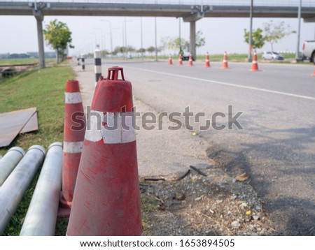 "Traffic cones and "" Diversion"" sign outside #1653894505"
