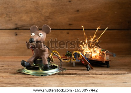 Rats from plasticine holding a power cord.breaking the wires. Electric shock,An explosion,Fire.