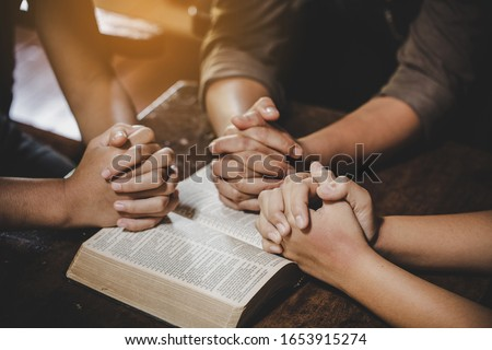 Group of different women praying together, Christians and Bible study concept.  Royalty-Free Stock Photo #1653915274