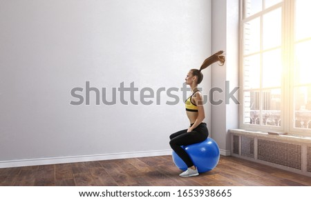 Sporty woman on fitness ball. Mixed media #1653938665
