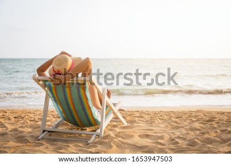 Summer travel beach vacation concept, Traveler asian woman with straw hat relax on chair beach at Koh Mak, Trad, Thailand #1653947503