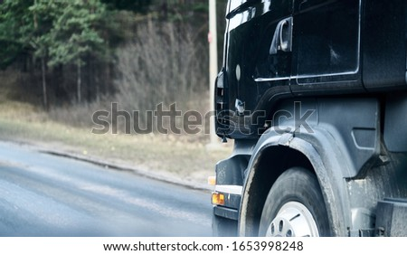 Truck wheel in rotation. Close up photo. Motion blur. Selective focus Royalty-Free Stock Photo #1653998248