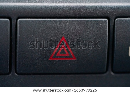 Emergency button in the car Royalty-Free Stock Photo #1653999226