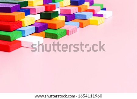 Concept creative, logical thinking, art,Creativity inspiration, order, business organization. Colored dominoes on a pink background #1654111960