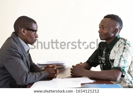 Handsome African business people men seriously and happily looking at each other in the eyes in office in Bamako, Mali #1654121212