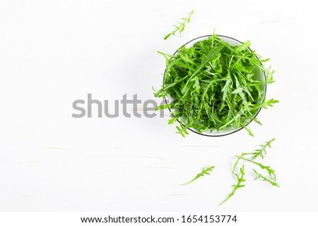 Fresh arugula or rocket leaves salad, rucola, top view #1654153774
