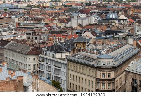 Skyline of Budapest, Hungary, Europe. Rooftop view from the tower of St. Stephen's Basilica. Historical buildings, towers and colorful rooftops. European capital city skyline. #1654199380