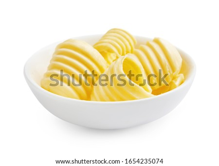 Butter curls or butter rolls in white bowl isolated on white background. #1654235074