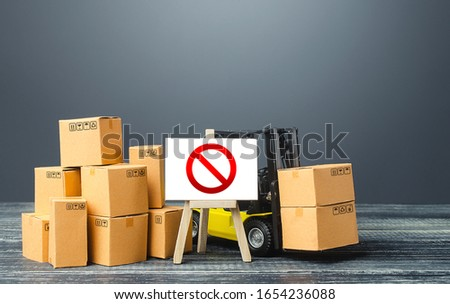 Warehouse with boxes and forklift and easel with prohibition sign NO. Out of stock. Restrictions ban on import goods. Sanctions, trade wars. Isolation and quarantine. manufacturers production slowdown