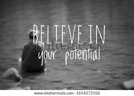 Blurry old woman at river with Inspirational quote - Believe in your potential #1654272106