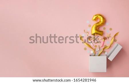 Number 2 birthday balloon celebration gift box lay flat explosion Royalty-Free Stock Photo #1654281946