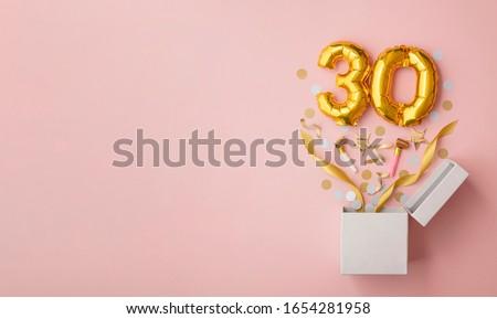 Number 30 birthday balloon celebration gift box lay flat explosion Royalty-Free Stock Photo #1654281958