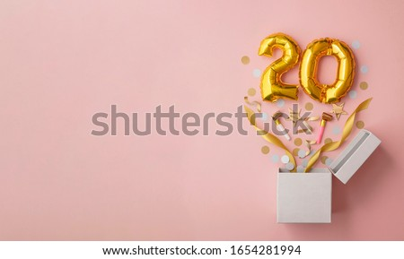 Number 20 birthday balloon celebration gift box lay flat explosion Royalty-Free Stock Photo #1654281994