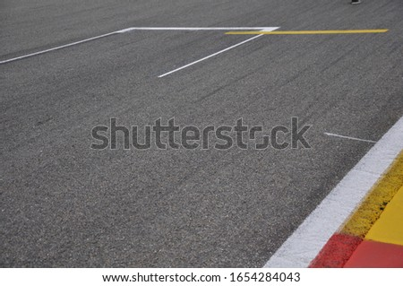 close up motor sport racetrack detail  #1654284043