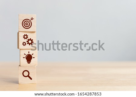 Concept of business strategy and action plan. Wood cube block stacking with icon Royalty-Free Stock Photo #1654287853