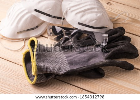 Dust masks, goggles and protective gloves. Personal protective equipment for workers Royalty-Free Stock Photo #1654312798