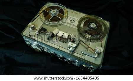 Analog Stereo Open Reel Tape Deck Recorder Player with Metal Reels,Vintage Analog Stereo Reel Deck Tape Recorder Royalty-Free Stock Photo #1654405405