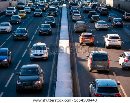 Moscow, Russia - February 8, 2020: Heavy traffic on the third traffic ring on a sunny Saturday afternoon. #1654508443