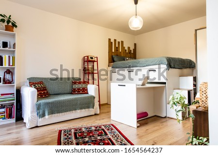 Tiny home - garsoniere - livingroom, bedroom and kitchen after reconstruction in Prague  Royalty-Free Stock Photo #1654564237