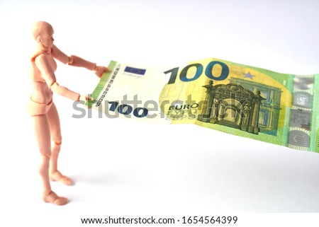 Dummy holding 100 euro banknote. Money or business concept. Abstract conceptual image Royalty-Free Stock Photo #1654564399