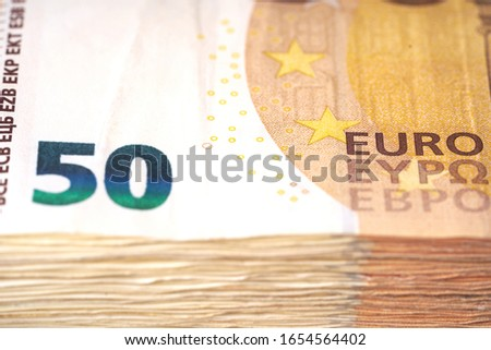 Money laundering on clothesline on light background. 50 eur notes. 50 eur banknotes Royalty-Free Stock Photo #1654564402