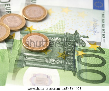 Money laundering on clothesline on light background. 100 eur notes. 100 eur banknotes. Royalty-Free Stock Photo #1654564408