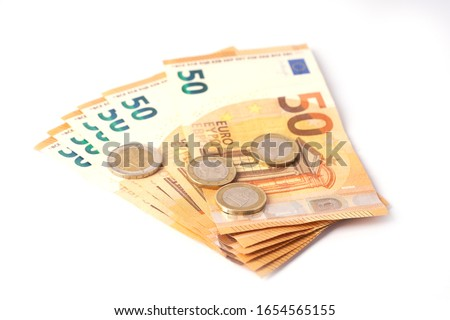 Money laundering on clothesline on light background. 50 eur notes. Royalty-Free Stock Photo #1654565155