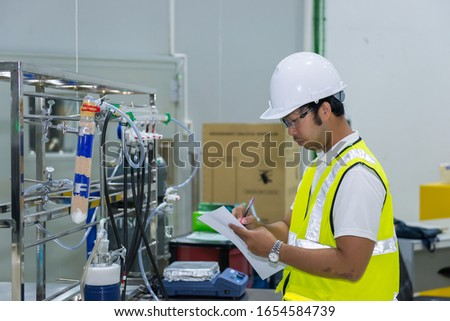 Asian engineer working at Operating hall,Thailand people wear helmet  work,He worked with diligence and patience #1654584739