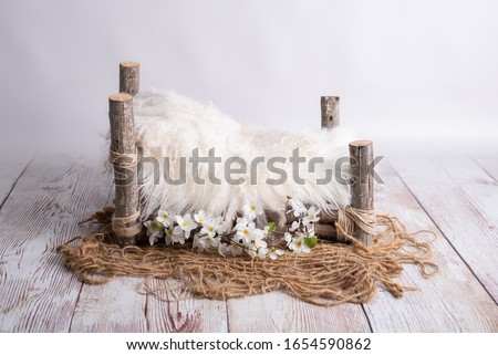 white wooden log bed for newborns Royalty-Free Stock Photo #1654590862