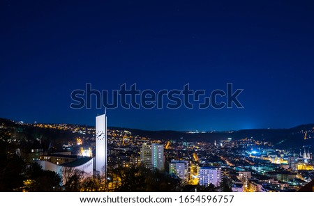 Germany, Stuttgart, Skyline, houses and churches of stuttgart city from above by night with starry sky #1654596757